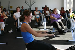 Instructor with an Indoor Rowing Class
